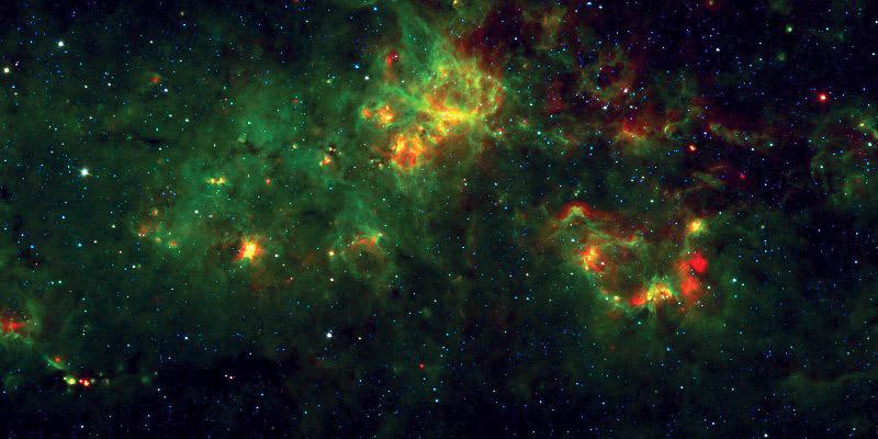 Obrázek 2: Snímek z infračerveného dalekohledu Spitzer, zachycující mezihvězdné bubliny všech možných rozměrů. Zelená barva zobrazuje záření studeného prachu na 8 μm, červená barva znázorňuje záření horkého prachu na 24 μm (Spitzer, Milky Way Project).
